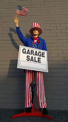 mannequin holding sign advertising robot for sale